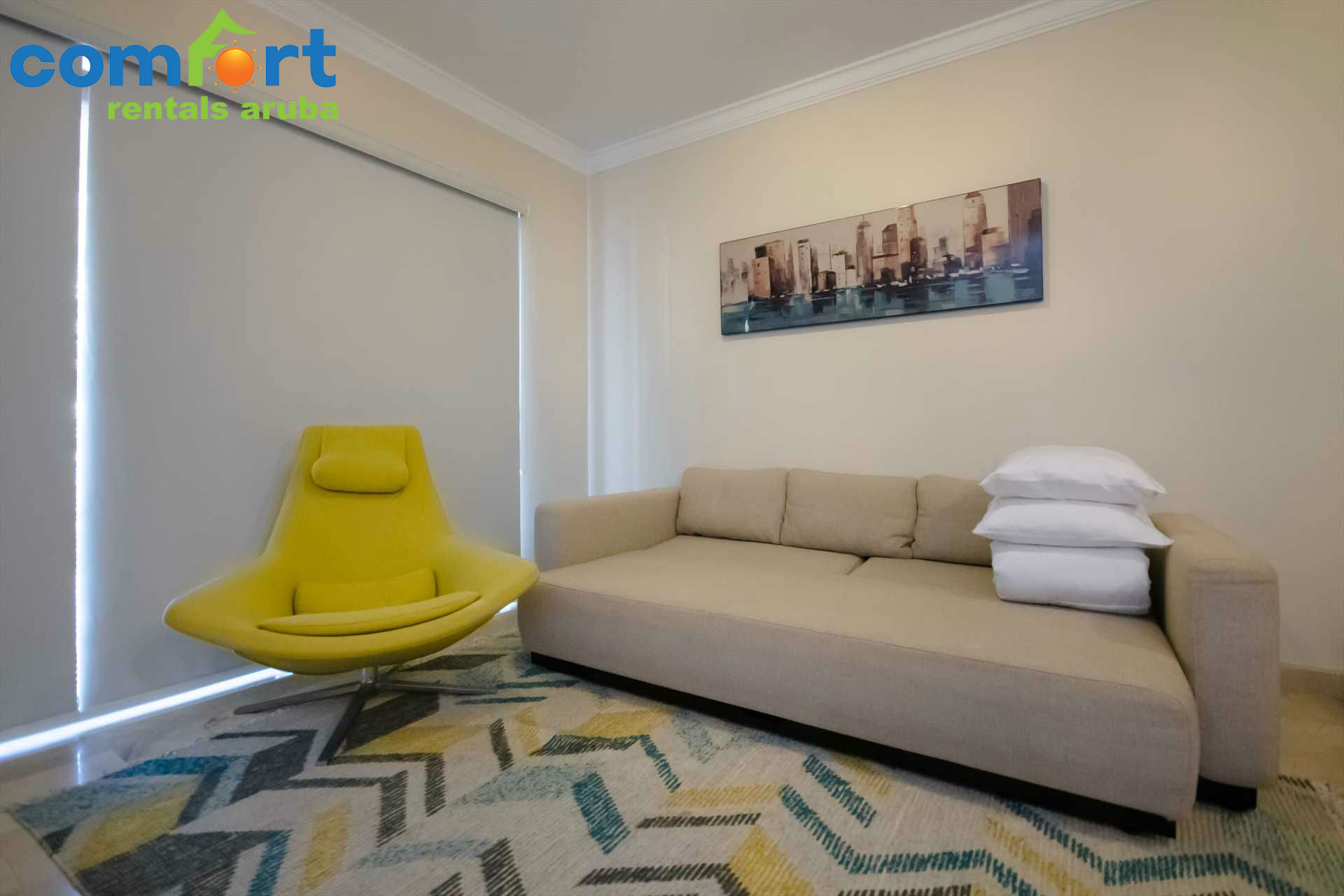 TThe sofa in the living room (that can be pulled out to accommodate up to two extra guests)