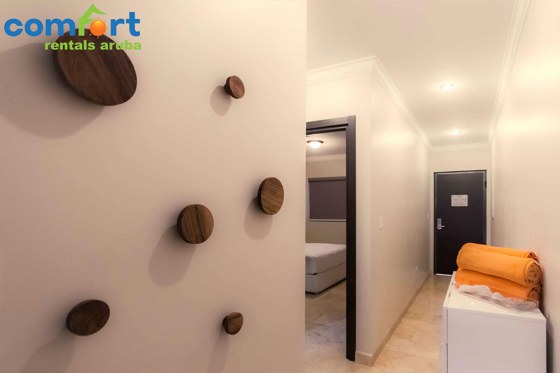 Condo entry door and hallway